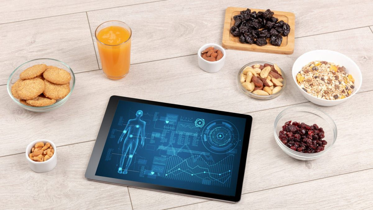 Collection of Foods and a tablet showing body composition