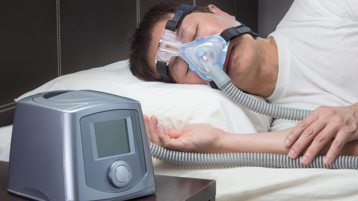 Man sleeping in CPAP machine